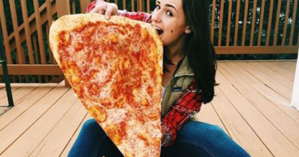Do Americans Really Have The Biggest Portion Sizes In The World? This Pizza Place Is Testing The Limit With Their Massive Slices!